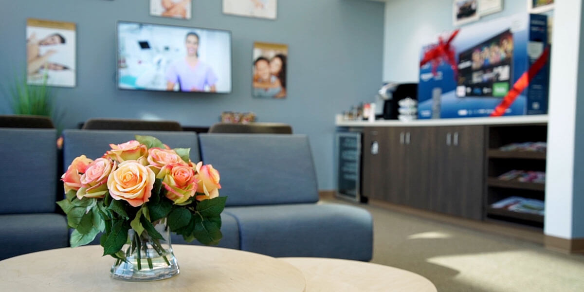 Receptionist and Patients Smilling